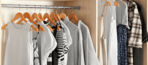 10 Essential Closet Staples to Have in Your Wardrobe Blog Feature Image of a closet with hanging garments