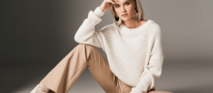 7 Tips to Elevate Your Style Instantly Blog Feature Image of a Woman dressed in neutrals sitting on the floor